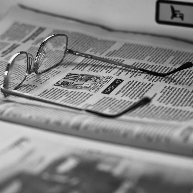 Glasses on Newspaper